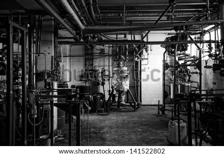 Lots of pipes at a chemical facility in black and white - stock photo