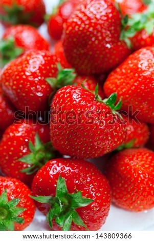 Lots of ripe perfect strawberries. Full frame background