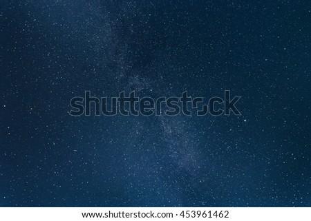Lots of shiny stars in the night sky. Milky way. - stock photo