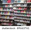 lots of sneaker shoes on sale - stock photo