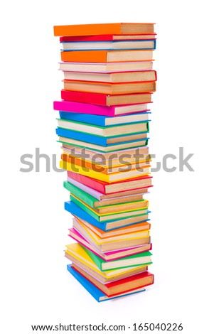 Lots of stacked colorful books on white background