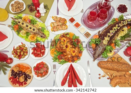 Lots of traditional festive food on table. Christmas table. - stock photo