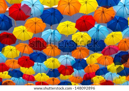 Lots of umbrellas coloring the sky in the city of Agueda, Portugal - stock photo