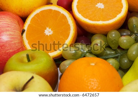 Lots of various fruits at the background - more similar photos in my portfolio - stock photo