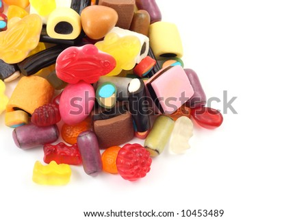 lots of various jelly beans in bowl isolated on white