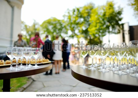 Lots of wine glasses during some festive event - stock photo