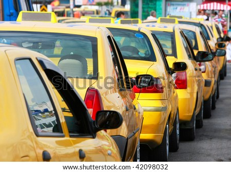 lots of yellow taxis in the street - stock photo