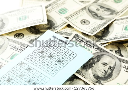 Lottery ticket and money, close up - stock photo