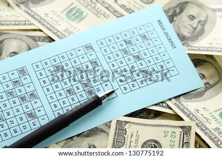 Lottery ticket, money and pen, close up - stock photo