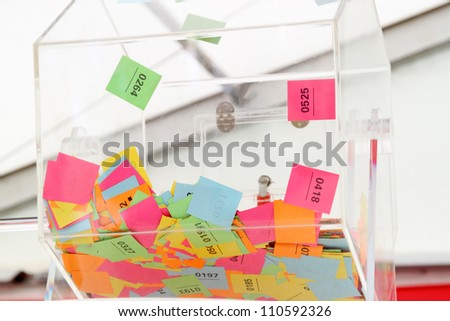 Lottery wheel with multicolored tickets - stock photo