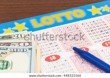 Lotto ticket gambling with pen and dollar banknote, ticket is mock-up - stock photo