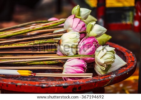 Lotus flowers used as offering in Wat Phra That Doi Suthep Buddhist temple, Chiang Mai, Thailand - stock photo