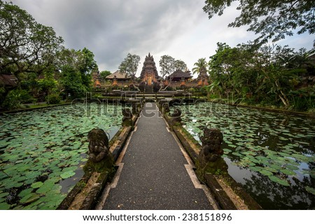 Lotus pond and Pura Saraswati temple in Ubud, Bali, Indonesia.  - stock photo