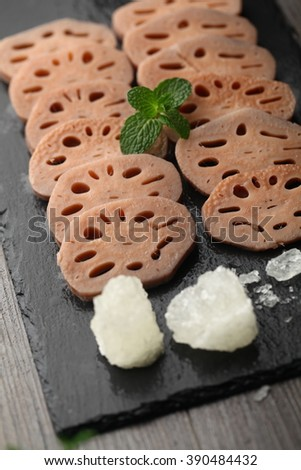Lotus root served on a wooden base