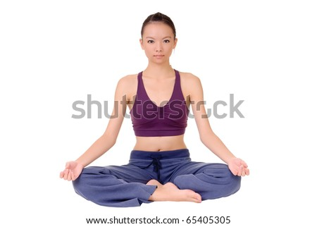 Lotus yoga pose by young Asian woman sitting on ground isolated over white. - stock photo