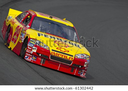 LOUDON, NH - SEP 18:  Kevin Harvick brings his Pennzoil Shell through the turns during practice for the Sylvania 300 race at the New Hampshire Motor Speedway in Loudon, NH on Sept 18, 2010 - stock photo