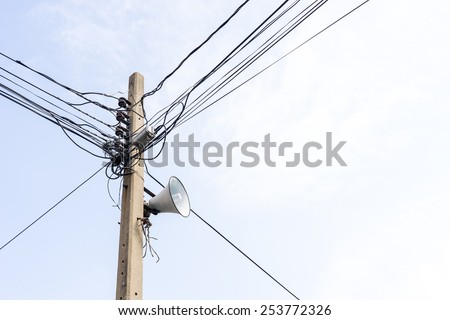 loudspeaker and Electric wire on the pole - stock photo