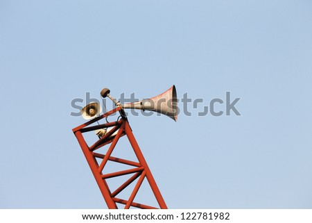 loudspeakers on a tall column - stock photo