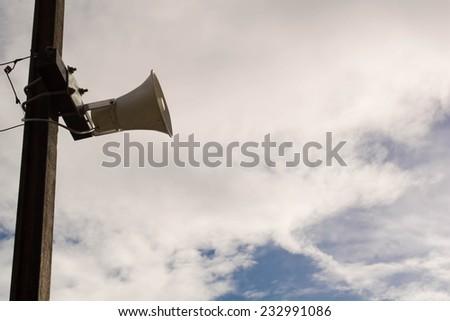 Loudspeakers under gray sky - stock photo