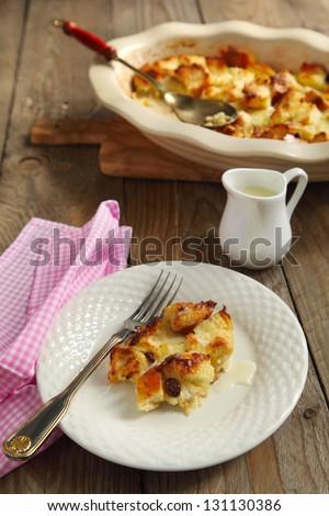 Louisiana bread pudding with bourbon sauce - stock photo