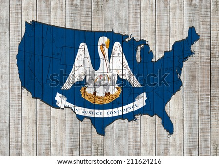 Louisiana flag with America map and wood background - stock photo