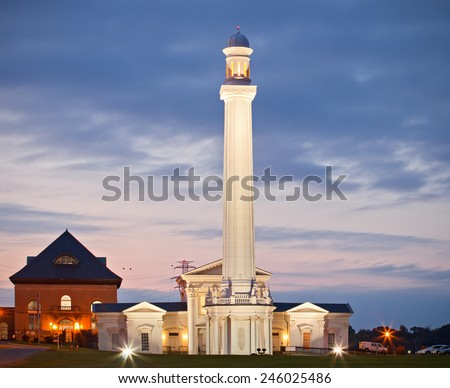 Louisville Kentucky USA, the oldest ornamental water tower in the world, famous city landmark at sunset or sunrise - stock photo