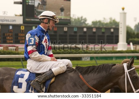 "LOUISVILLE, KY - JUNE 14: Jockey Calvin Borel heads to the Winner's Circle aboard ""Ready's Rocket"" after a winning ride at Churchill Downs on June 14, 2009 in Louisville, KY. - stock photo"
