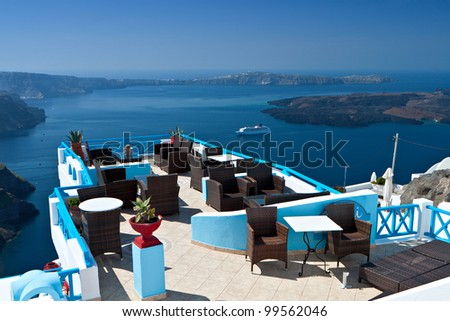Lounge bar at Santorini island in Greece with spectacular view at the volcanic  caldera and the sea - stock photo