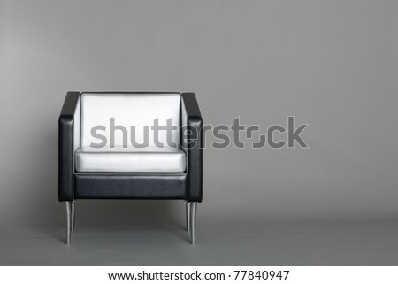 Lounge chair with a gray background. Modern design. - stock photo