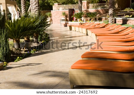 lounge chairs at a luxury resort - stock photo