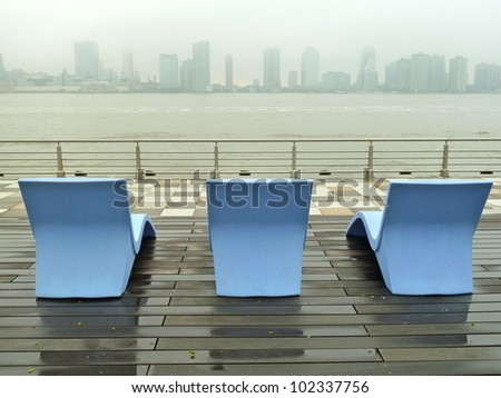 lounge chairs facing New Jersey on a rainy day