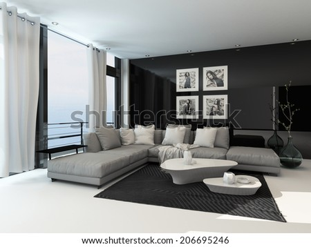 Lounge interior in a coastal apartment with floor to ceiling windows overlooking the sea, curtains, a comfortable beige corner lounge unit, carpet and modern coffee tables with dark accents - stock photo
