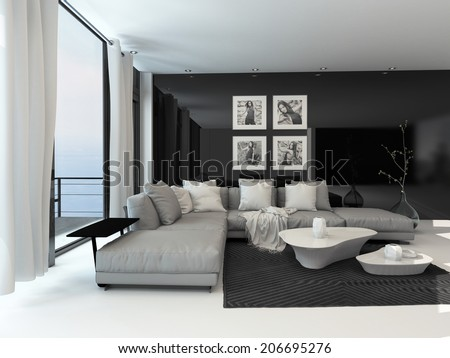 Lounge interior with a dark accent wall and floor-to-ceiling window overlooking the ocean furnished with a comfortable beige lounge suite and modern tables - stock photo