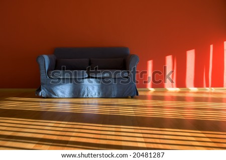Lounge red room with blue couch - stock photo