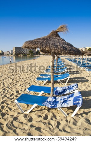 loungers on the beach - stock photo