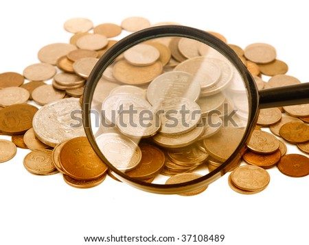 Loupe and coins on white background - stock photo