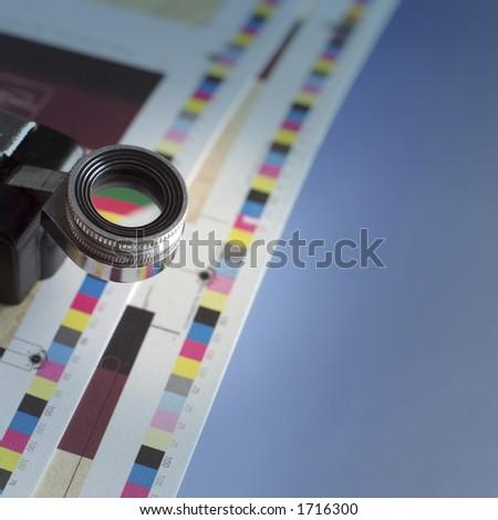 Loupe on press sheets. - stock photo