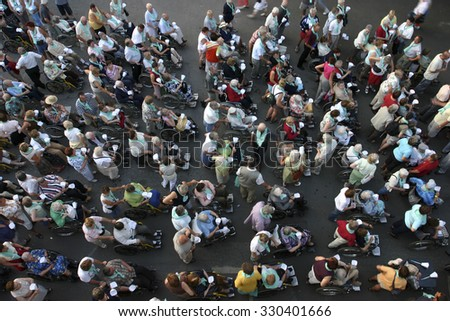 LOURDES, BELGIUM, AUGUST 9: Aerial view of group of people during a ceremony in Lourdes, France 2005