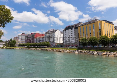 LOURDES, FRANCE - JULY 23, 2014: Hotels in Lourdes situated along the river Gave de Pau. Lourdes is famous for the Marian spirit of Our Lady of Lourdes to have occurred in 1858 to Bernadette Soubirous - stock photo