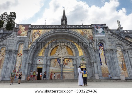 LOURDES - JULY 23, 2014: Notre Dame du Rosaire de Lourdes or the Basilica of our Lady of the Rosary is a Roman Catholic church and minor basilica within the Sanctuary of Our Lady of Lourdes in France. - stock photo