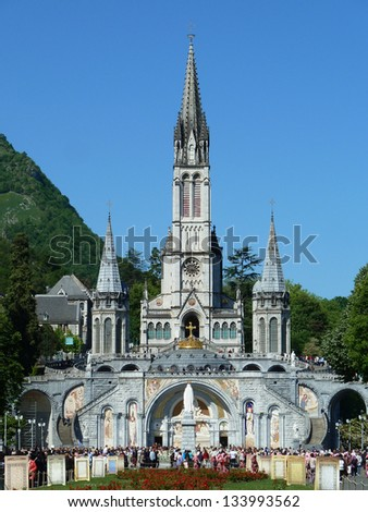LOURDES - MAY 8: The Basilica of our Lady of the Rosary on May 8, 2011 in Lourdes (France). The Basilica of our Lady of the Rosary is a Roman Catholic church in the Sanctuary of Our Lady of Lourdes. - stock photo