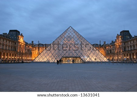 Louvre courtyard - evening - stock photo