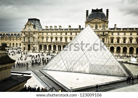 Louvre pyramid in Paris - stock photo