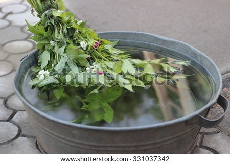 Lovage in the washbowl with water