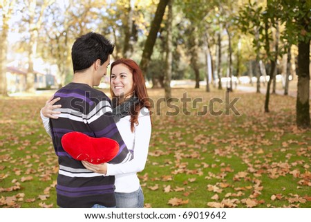 Love and affection between a young couple at valentine day (selective focus with shallow DOF) - stock photo