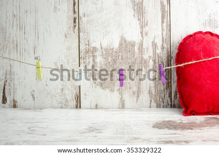 Love and heart on a red background congratulate Valentine's Day, soft photo