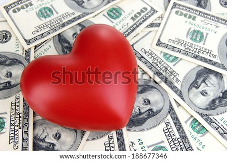 Love and money concept. Heart and American currency close up - stock photo