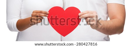 love and relationships concept - closeup of couple hands with heart