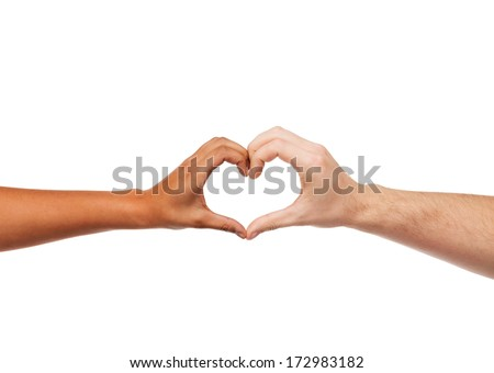 love and relationships concept - closeup of woman and man hands showing heart shape - stock photo