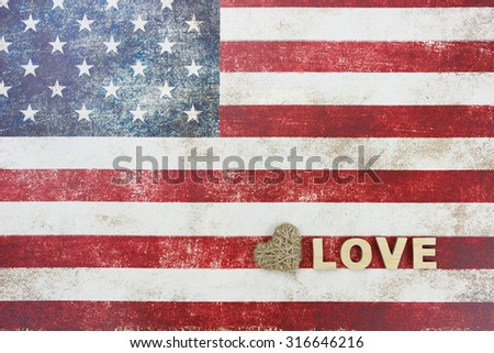 Love and rope heart on vintage American flag canvas background - stock photo